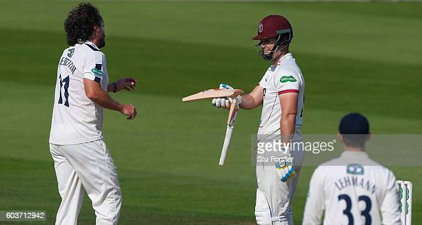 Yorkshire bowler Ryan Sidebottom shares a joke with Somerset batsman Jim Allenby after the batsman's bat snaps during day two of the Division One...