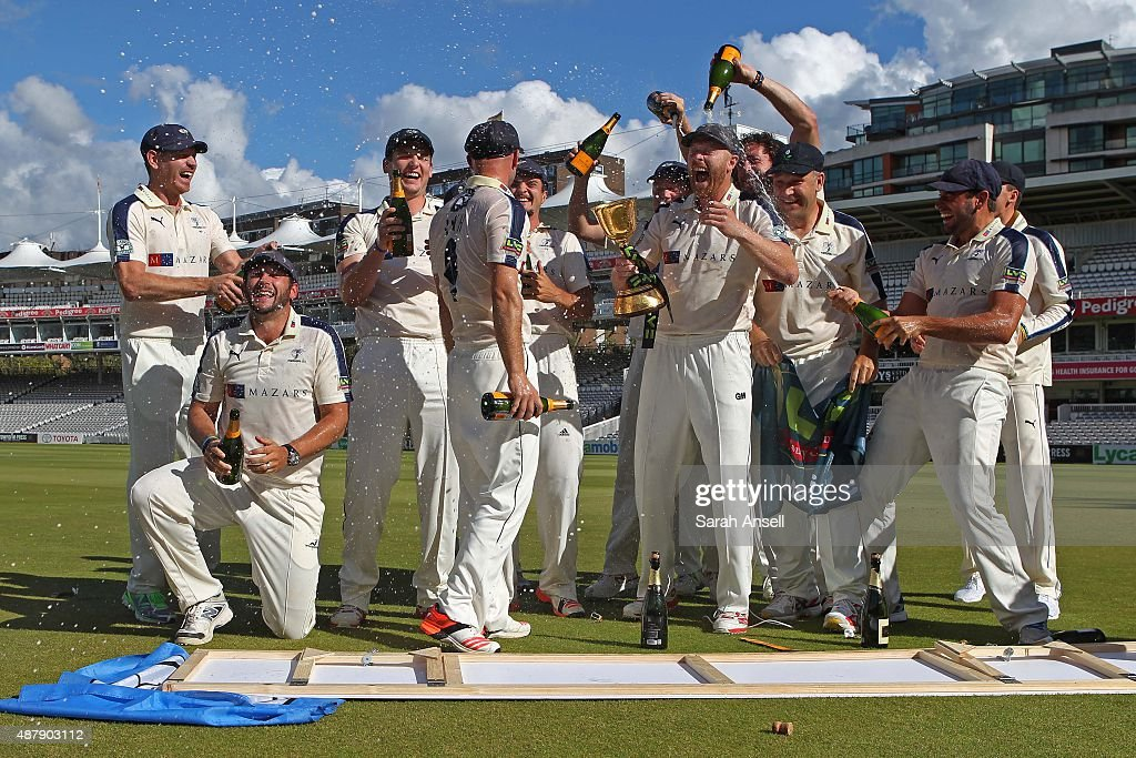 Yorkshire captain Andrew Gale has champagne tipped over him by his team mates as they celebrate being crowned LV County Champions following the LV...