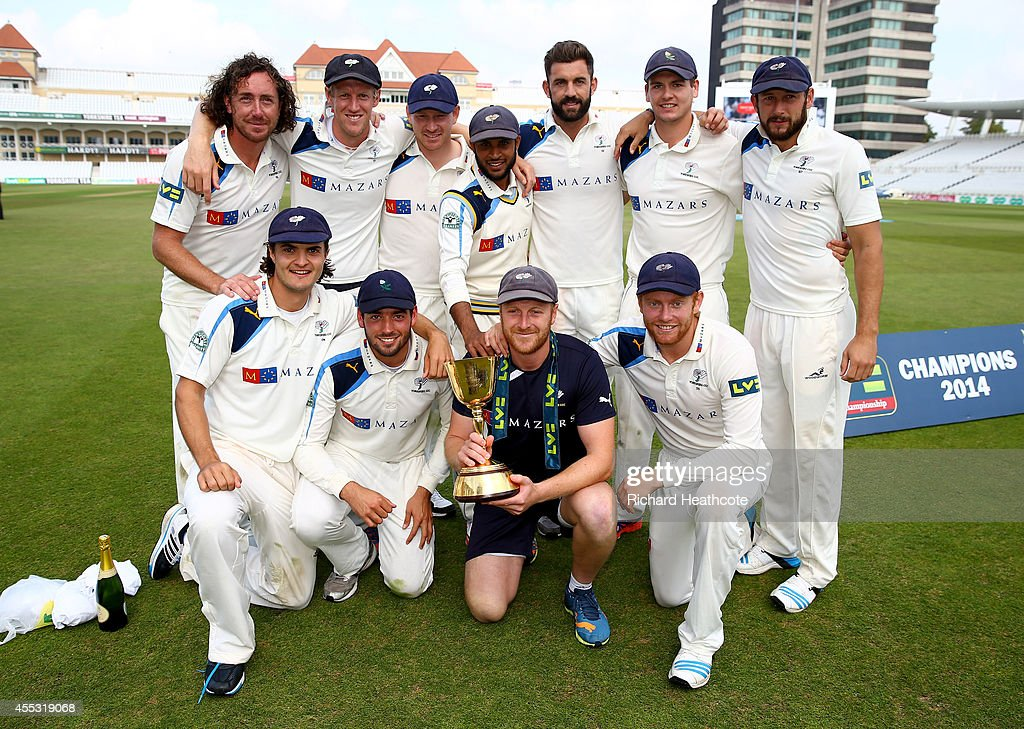 Yorkshire captain Andrew Gale joins his team mates to celebrate with the County Championship Trophy after beating Notts to secure the league during...