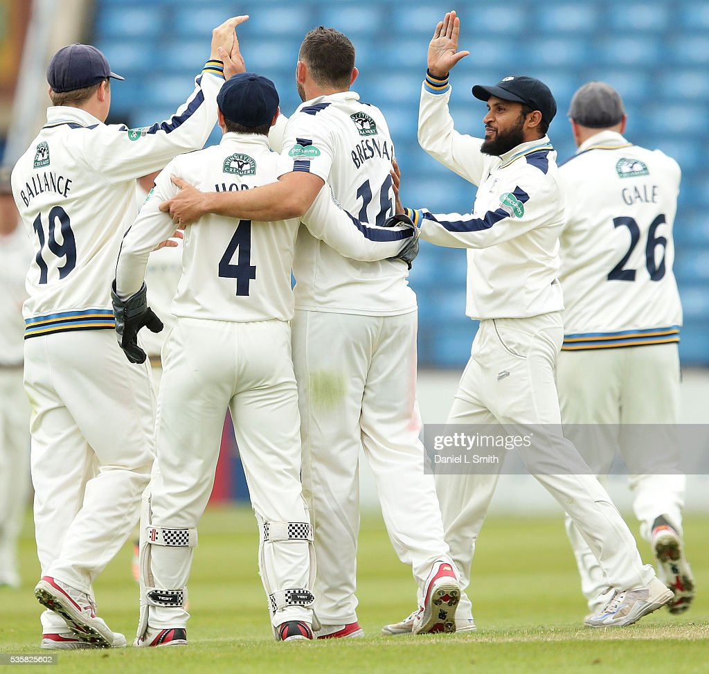 Yorkshire celebrate the dismissal of Haseeb Hameed of Lancashire during day two of the Specsavers County Championship: Division One match between Yorkshire and Lancashire at Headingley on May 30, 2016 in Leeds, England.