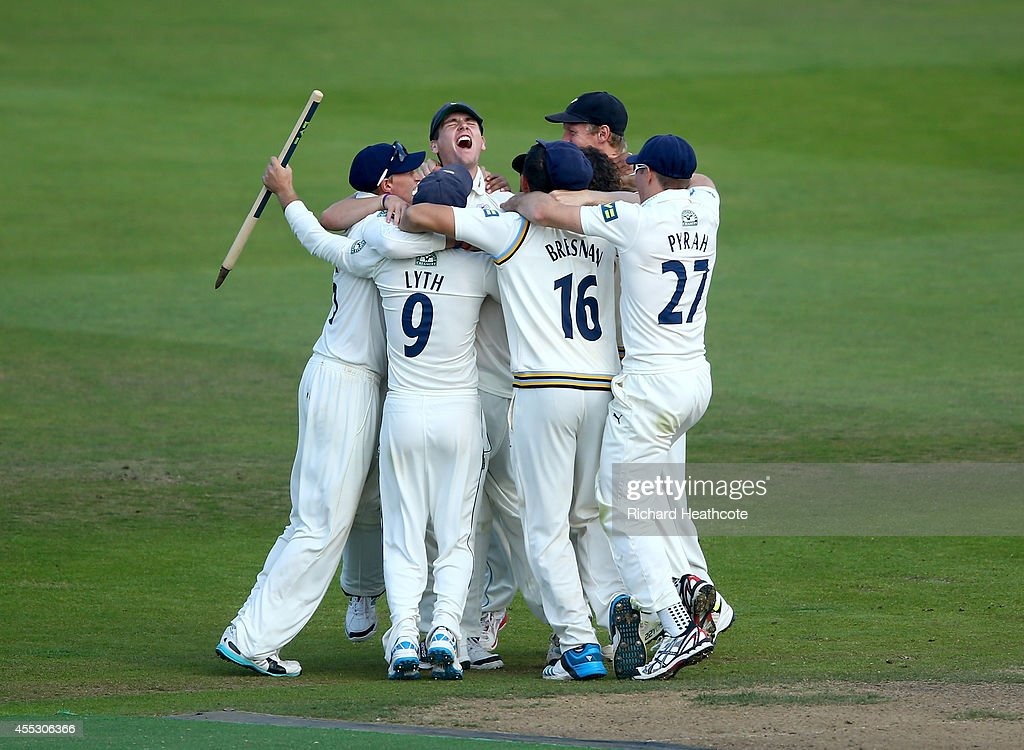 Yorkshire celebrate victory after beating Notts to secure the league during the fourth day of the LV County Championship match between...