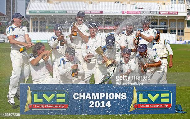 Yorkshire celebrate with the County Championship Trophy after beating Notts to secure the league during the fourth day of the LV County Championship...