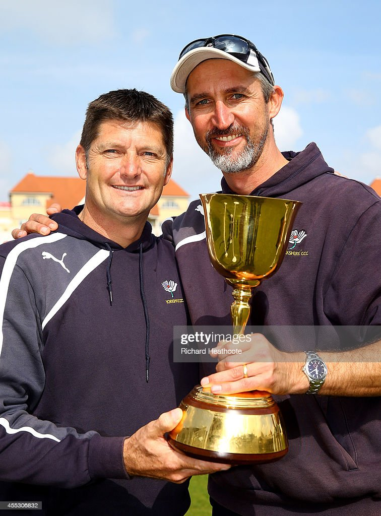 Yorkshire director of cricket Martyn Moxon and coach Jason Gillespie pose with the trophy after Yorkshire beat Notts to secure the league during the...