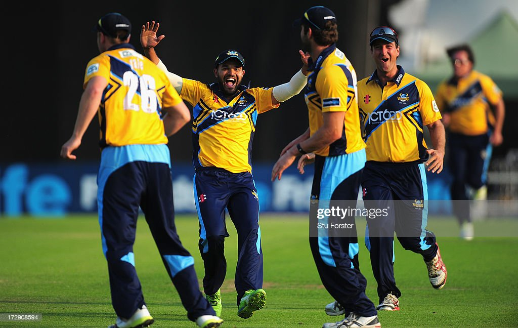 Yorkshire fielder Azeem Rafiq (c) rushes to congratulate Liam Plunkett ( 2nd r) after he had caught Lancashire batsman Tom Smith during the Friends Life T20 match between Yorkshire Carnegie and Lancashire Lightning at Headingley Carnegie Stadium on July 5, 2013 in Leeds, England.