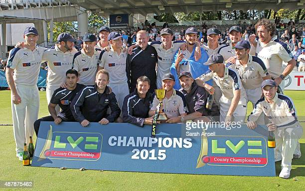 Yorkshire players and staff celebrate after being presented with the LV County Championship trophy after the LV County Championship match between...
