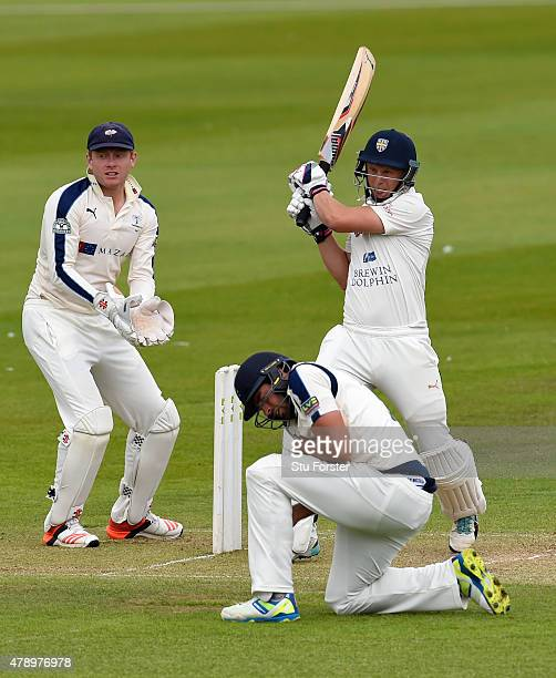 Yorkshire wicketkeeper Jonny Bairstow looks on as Durham batsman Scott Borthwick pulls a ball to the boundary during day two of the LV County...