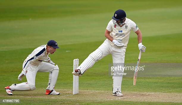 Yorkshire wicketkeeper Jonny Bairstow reacts as Durham batsman Ryan Pringle kicks the ball away from hitting his stumps during day two of the LV...