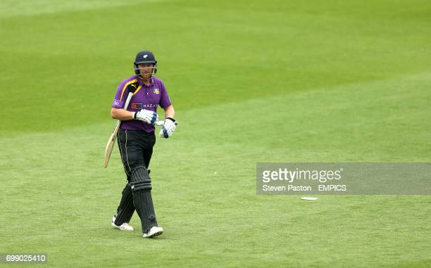Yorkshire's Andrew Gale walks off the field after being bowled for a LBW by Surrey's Sam