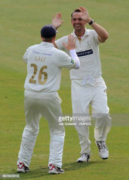 Yorkshire's Gideon Jacobus Kruis and Andrew Gale celebrate taking the wicket of Surrey's Scott Newman
