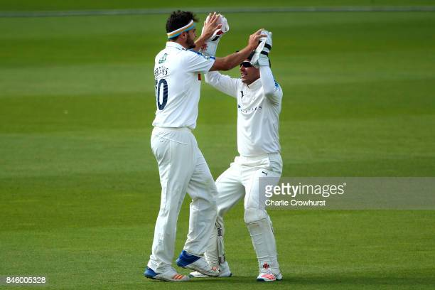 Yorkshire's Jack Brooks celebrates taking the wicket of Surrey's Rory Burns with team mate Andy Hodd during day one of the Specsavers County...