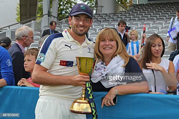 Yorkshire's Jack Leaning celebrates with the LV County Championship Trophy following the LV County Championship match between Middlesex and Yorkshire...