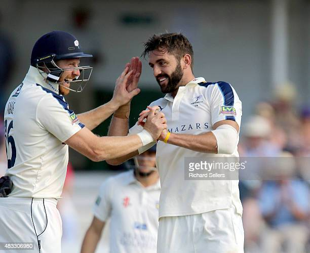 Yorkshire's Liam Plunkett and Yorkshire's Andrew Gale celebrate during day one of the LV County Championship division one match between Yorkshire and...