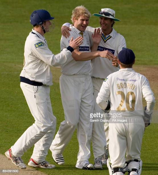 Yorkshire's Matthew Hoggard celebrates with Andrew Gale and Michael Vaughan after dismissing Nottinghamshire's Will Jefferson for a duck during the...