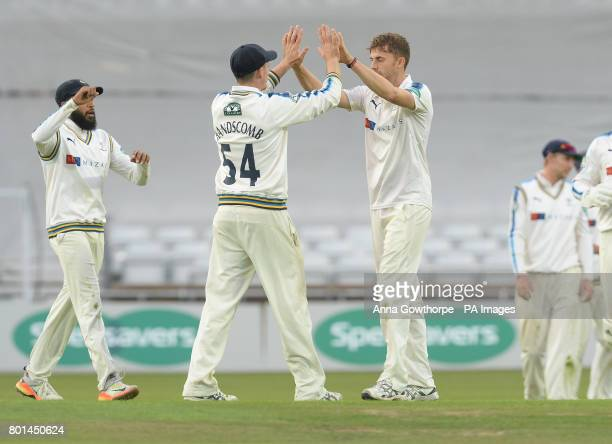 Yorkshire's Peter Handscomb and Ben Coad celebrate taking the wicket of Surrey's Ben Foakes during the Specsavers County Championship Division One...