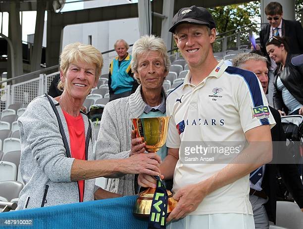 Yorkshire's Steve Patterson with his parents and the LV County Championship Trophy following the LV County Championship match between Middlesex and...