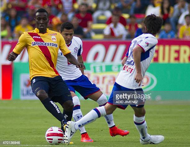 Yorleys Mena of Morelia vies for the ball with Julio Cesar Dominguez and Mauro FOrmica of Cruz Azul during their Mexican Clausura tournament football...