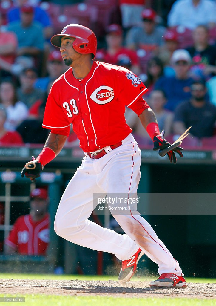 Yorman Rodriguez #33 of the Cincinnati Reds watches the ball fly into left field against the Pittsburgh Pirates at Great American Ball Park on September 27, 2014 in Cincinnati, Ohio.
