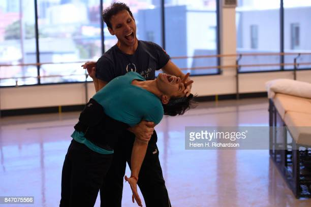 DENVER CO SEPTEMBER 12 Yosavni Ramos in front and fellow dancer Domenico Luciano in back rehearse for the upcoming production of Dracula at Colorado...
