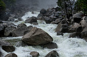 Raging water over large granite boulders