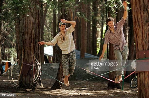 Yosemite Valley CA Aaron Jones from Kentucky and Jeff Gardner from Virginia practice on a slackline strung between trees in Camp Four The slackline...