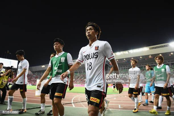 Yoshiaki Komai and Urawa Red Diamonds players leave the pith after their 24 defeat in the JLeague J1 match between Cerezo Osaka and Urawa Red...