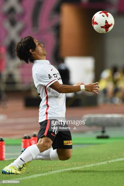 Yoshiaki Komai of Urawa Red Diamonds controls the ball during the JLeague J1 match between Cerezo Osaka and Urawa Red Diamonds at Yanmar Stadium...