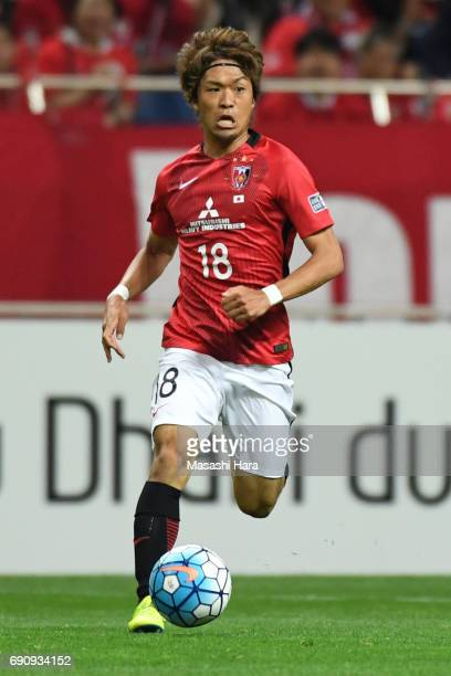 Yoshiaki Komai of Urawa Red Diamonds in action during the AFC Champions League Round of 16 match between Urawa Red Diamonds and Jeju United FC at...