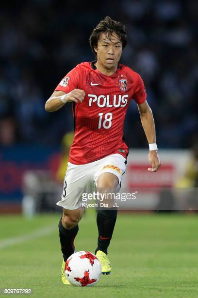 Yoshiaki Komai of Urawa Red Diamonds in action during the JLeague J1 match between Kawasaki Frontale and Urawa Red Diamonds at Todoroki Stadium on...