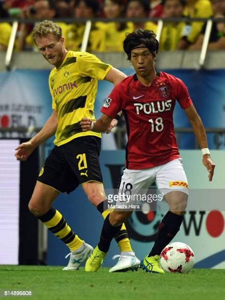 Yoshiaki Komai of Urawa Red Diamonds in action during the preseason friendly match between Urawa Red Diamonds and Borussia Dortmund at Saitama...
