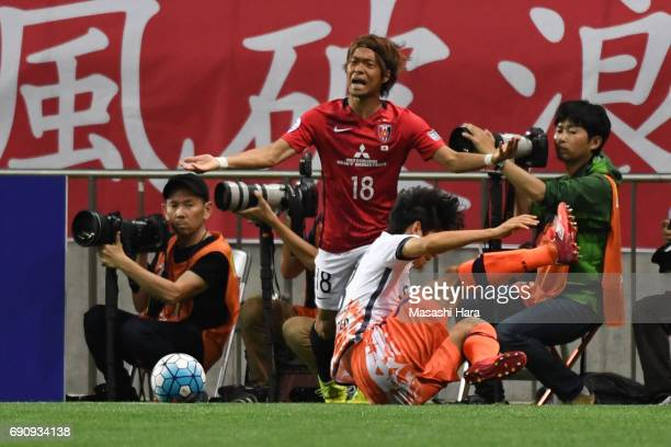 Yoshiaki Komai of Urawa Red Diamonds looks on during the AFC Champions League Round of 16 match between Urawa Red Diamonds and Jeju United FC at...