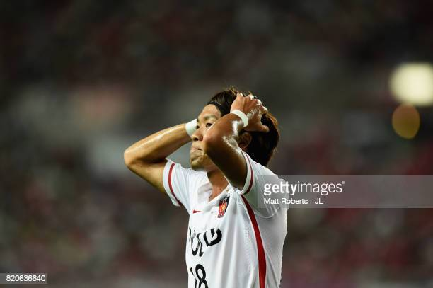 Yoshiaki Komai of Urawa Red Diamonds reacts during the JLeague J1 match between Cerezo Osaka and Urawa Red Diamonds at Yanmar Stadium Nagai on July...