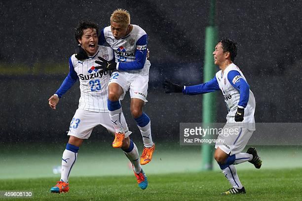 Yoshiaki Takagi of Shimizu SPulse celebrates scoring his team's second goal with his teammates Kazuya Murata and Shota Kaneko during the 94th...