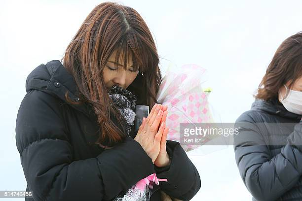 Yoshie Satake who lost her daughter by tsunami prays at Fukanuma beach on March 11 2016 in Sendai Japan Today marks the fifth anniversary of the...