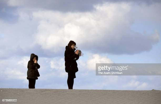 Yoshie Satake who lost her daughter prays at a beach on the sixth anniversary of the Great East Japan Earthquake and following tsunami on March 11...