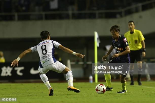 Yoshifumi Kashiwa of Sanfrecce Hiroshima takes on Yosuke Ideguchi of Gamba Osaka during the JLeague J1 match between Sanfrecce Hiroshima and Gamba...