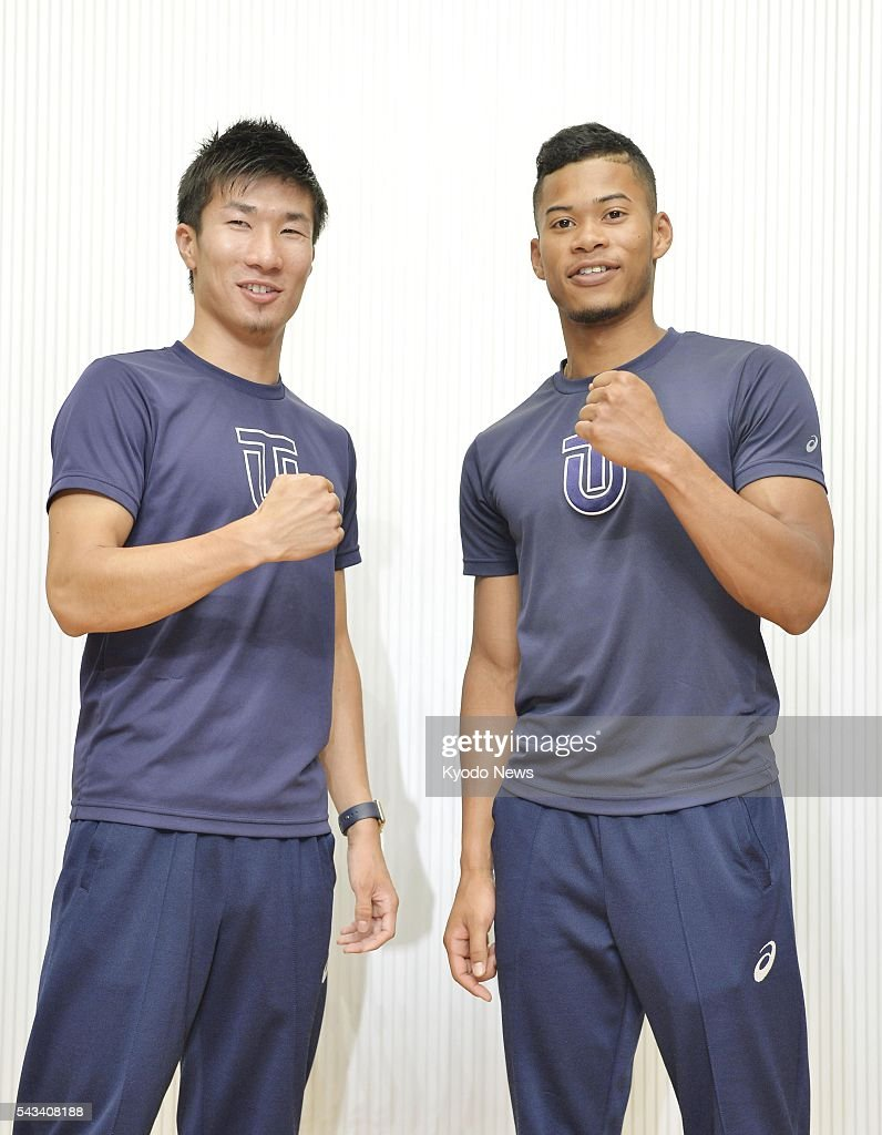 Yoshihide Kiryu (L) and Julian Walsh, track and field athletes at Tokyo's Toyo University, pose for a photo during a send-off ceremony at the university on June 28, 2016, ahead of their participation in the Rio de Janeiro Olympic Games. Kiryu will compete in the men's 100 meters, while Walsh will compete in the men's 400 meters.