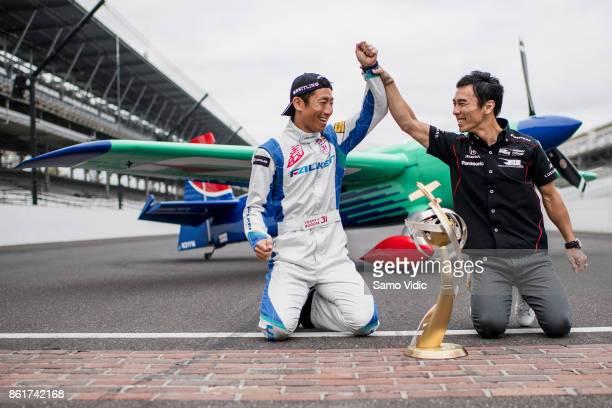 Yoshihide Muroya of Japan celebrates his World Champion title on the yard of bricks with 2017 Indy 500 winner and former Formula 1 driver Takuma Sato...