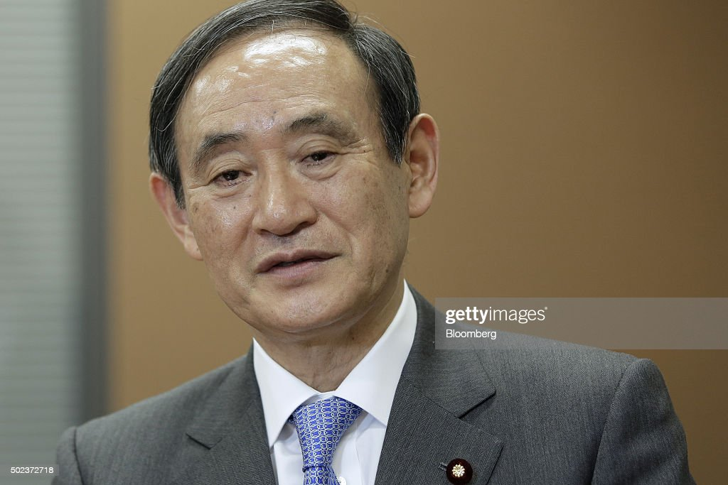 <a gi-track='captionPersonalityLinkClicked' href=/galleries/search?phrase=Yoshihide+Suga&family=editorial&specificpeople=3868279 ng-click='$event.stopPropagation()'>Yoshihide Suga</a>, Japan's chief cabinet secretary, poses for a photograph following an interview in Tokyo, Japan, on Wednesday, Dec. 23, 2015. The Bank of Japan still has policy options to continue its unprecedented monetary easing, Suga said in an interview days after the central bank announced it wouldn't expand its main stimulus target. Photographer: Kiyoshi Ota/Bloomberg via Getty Images