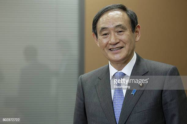 Yoshihide Suga Japan's chief cabinet secretary poses for a photograph following an interview in Tokyo Japan on Wednesday Dec 23 2015 The Bank of...