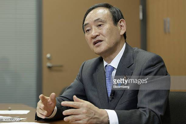 Yoshihide Suga Japan's chief cabinet secretary speaks during an interview in Tokyo Japan on Wednesday Dec 23 2015 The Bank of Japan still has policy...