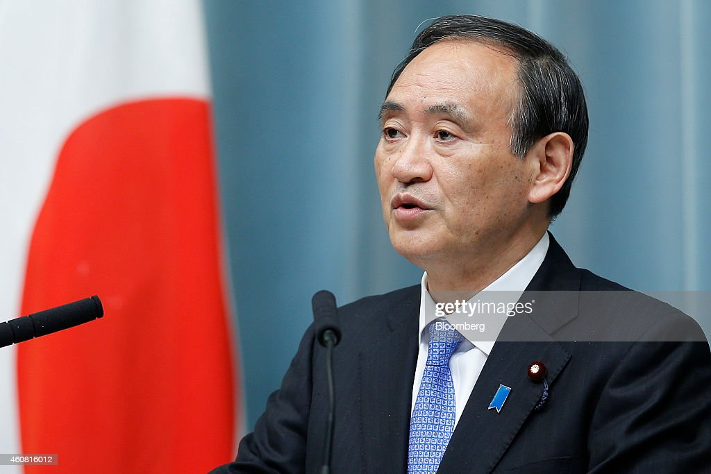 <a gi-track='captionPersonalityLinkClicked' href=/galleries/search?phrase=Yoshihide+Suga&family=editorial&specificpeople=3868279 ng-click='$event.stopPropagation()'>Yoshihide Suga</a>, Japan's re-appointed chief cabinet secretary, speaks during a news conference announcing Japan's new cabinet members at the prime minister's official residence in Tokyo, Japan, on Wednesday, Dec. 24, 2014. Japanese Prime Minister Shinzo Abe appointed a former soldier and security veteran as his new defense minister, as he prepares to push through legislation to toughen the country's military stance amid a dispute with China. Photographer: Kiyoshi Ota/Bloomberg via Getty Images