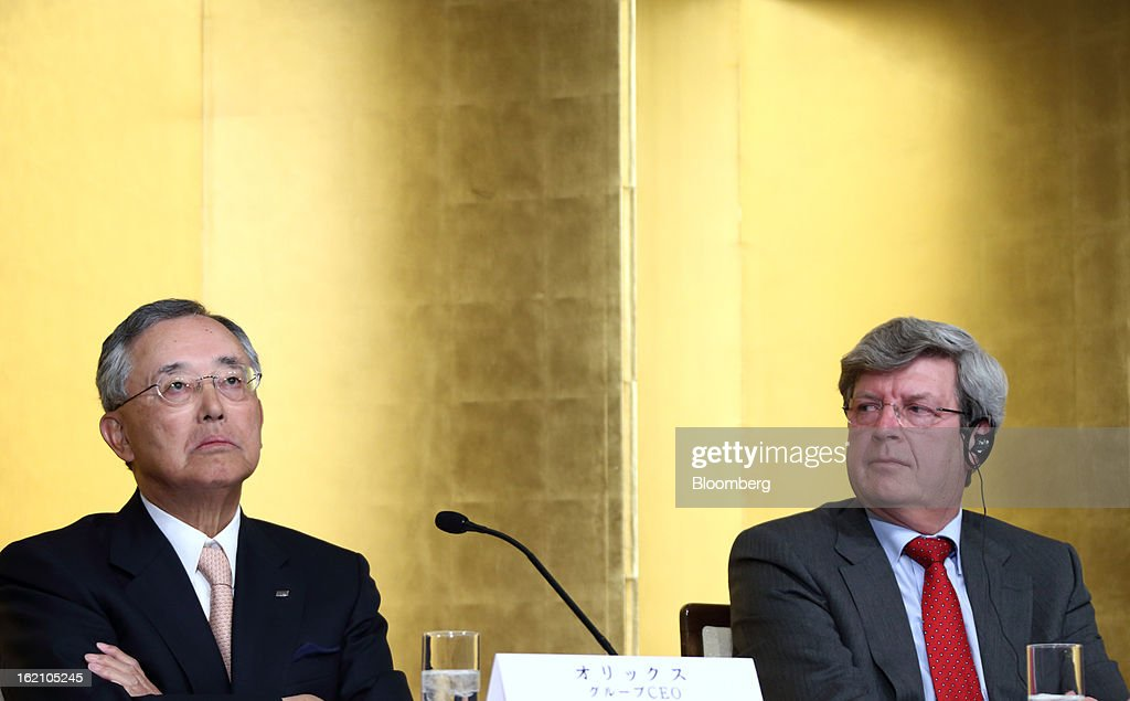 Yoshihiko Miyauchi, chairman and chief executive officer of Orix Corp., left, pauses as Piet Moerland, chairman of Rabobank Groep, looks on during a news conference in Tokyo, Japan, on Tuesday, Feb. 19, 2013. Orix Corp. agreed to buy Rabobank Groep's asset-management unit for 1.94 billion euros ($2.6 billion) in its largest-ever acquisition. Photographer: Tomohiro Ohsumi/Bloomberg via Getty Images