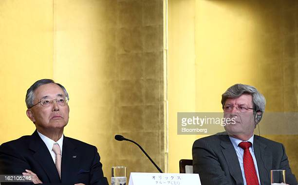 Yoshihiko Miyauchi chairman and chief executive officer of Orix Corp left pauses as Piet Moerland chairman of Rabobank Groep looks on during a news...