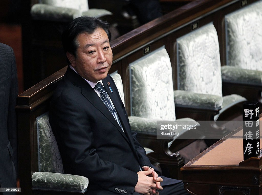 <a gi-track='captionPersonalityLinkClicked' href=/galleries/search?phrase=Yoshihiko+Noda&family=editorial&specificpeople=6441440 ng-click='$event.stopPropagation()'>Yoshihiko Noda</a>, Japan's prime minister, attends a plenary session at the Lower House of Parliament in Tokyo, Japan, on Friday, Nov. 16, 2012. Noda dissolved the lower house of parliament today after the upper house passed a bill to issue bonds to finance spending for the rest of this fiscal year, following a months-long impasse that left the government weeks away from running out of money. The election will be held on Dec. 16. Photographer: Junko Kimura/Bloomberg via Getty Images