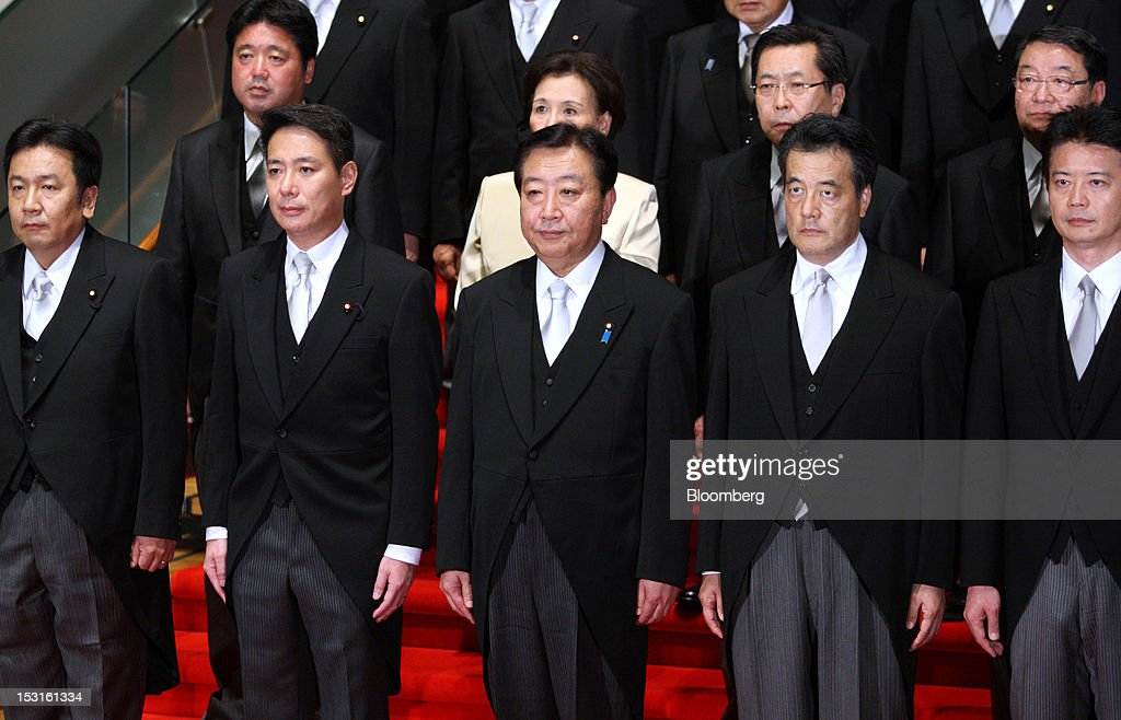<a gi-track='captionPersonalityLinkClicked' href=/galleries/search?phrase=Yoshihiko+Noda&family=editorial&specificpeople=6441440 ng-click='$event.stopPropagation()'>Yoshihiko Noda</a>, Japan's prime minister, center, poses for a photograph with cabinet members <a gi-track='captionPersonalityLinkClicked' href=/galleries/search?phrase=Yukio+Edano&family=editorial&specificpeople=6547820 ng-click='$event.stopPropagation()'>Yukio Edano</a>, economy, trade and industry minister, from left to right, <a gi-track='captionPersonalityLinkClicked' href=/galleries/search?phrase=Seiji+Maehara&family=editorial&specificpeople=2247548 ng-click='$event.stopPropagation()'>Seiji Maehara</a>, national strategy and economy minister, <a gi-track='captionPersonalityLinkClicked' href=/galleries/search?phrase=Katsuya+Okada&family=editorial&specificpeople=226520 ng-click='$event.stopPropagation()'>Katsuya Okada</a>, deputy prime minister, and <a gi-track='captionPersonalityLinkClicked' href=/galleries/search?phrase=Koichiro+Gemba&family=editorial&specificpeople=7046304 ng-click='$event.stopPropagation()'>Koichiro Gemba</a>, foreign minister, at the prime minister's official residence in Tokyo, Japan, on Monday, Oct. 1, 2012. Noda named 10 new ministers ahead of an election that may come by the end of the year. Photographer: Tomohiro Ohsumi/Bloomberg via Getty Images