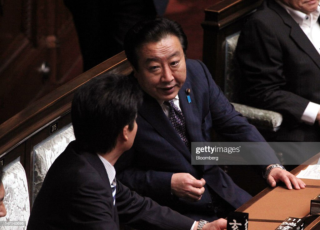 <a gi-track='captionPersonalityLinkClicked' href=/galleries/search?phrase=Yoshihiko+Noda&family=editorial&specificpeople=6441440 ng-click='$event.stopPropagation()'>Yoshihiko Noda</a>, Japan's prime minister, center, speaks with <a gi-track='captionPersonalityLinkClicked' href=/galleries/search?phrase=Koichiro+Gemba&family=editorial&specificpeople=7046304 ng-click='$event.stopPropagation()'>Koichiro Gemba</a>, Japan's foreign minister, during a plenary session at the lower house of the Diet in Tokyo, Japan, on Tuesday, June 26, 2012. Noda's bill to double Japan's five percent sales tax passed the lower house of parliament after months of wrangling, intensifying a ruling party split that could threaten its majority. Photographer: Haruyoshi Yamaguchi/Bloomberg via Getty Images