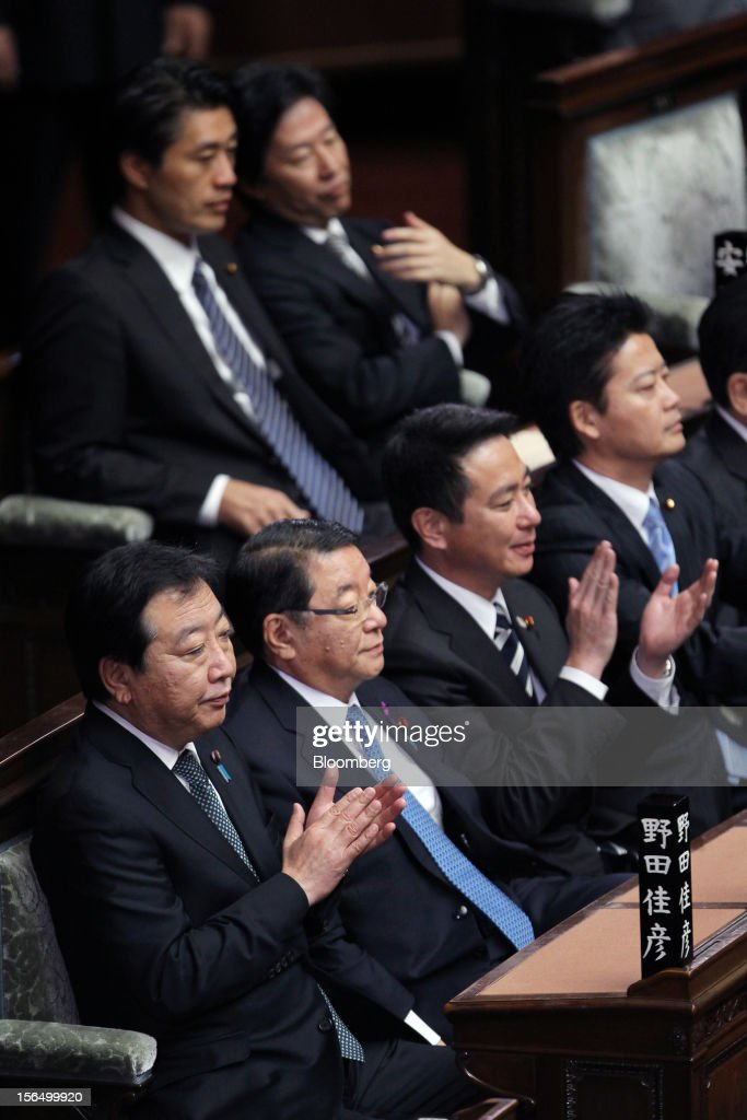 Yoshihiko Noda, Japan's prime minister, from left, Osamu Fujimura, chief cabinet secretary, Seiji Maehara, national strategy and economy minister, and Koichiro Genba, foreign minister, attend a plenary session at the Lower House of Parliament in Tokyo, Japan, on Friday, Nov. 16, 2012. Noda dissolved the lower house of parliament today after the upper house passed a bill to issue bonds to finance spending for the rest of this fiscal year, following a months-long impasse that left the government weeks away from running out of money. The election will be held on Dec. 16. Photographer: Junko Kimura/Bloomberg via Getty Images
