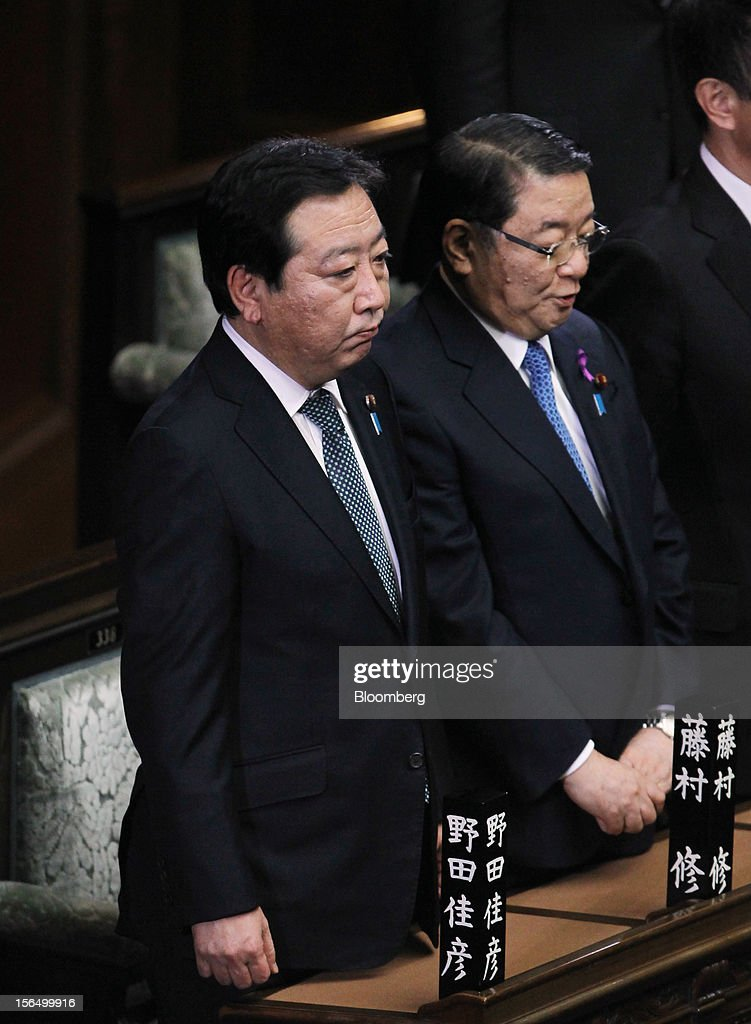 <a gi-track='captionPersonalityLinkClicked' href=/galleries/search?phrase=Yoshihiko+Noda&family=editorial&specificpeople=6441440 ng-click='$event.stopPropagation()'>Yoshihiko Noda</a>, Japan's prime minister, left, and <a gi-track='captionPersonalityLinkClicked' href=/galleries/search?phrase=Osamu+Fujimura&family=editorial&specificpeople=7120610 ng-click='$event.stopPropagation()'>Osamu Fujimura</a>, chief cabinet secretary, attend a plenary session at the Lower House of Parliament in Tokyo, Japan, on Friday, Nov. 16, 2012. Noda dissolved the lower house of parliament today after the upper house passed a bill to issue bonds to finance spending for the rest of this fiscal year, following a months-long impasse that left the government weeks away from running out of money. The election will be held on Dec. 16. Photographer: Junko Kimura/Bloomberg via Getty Images