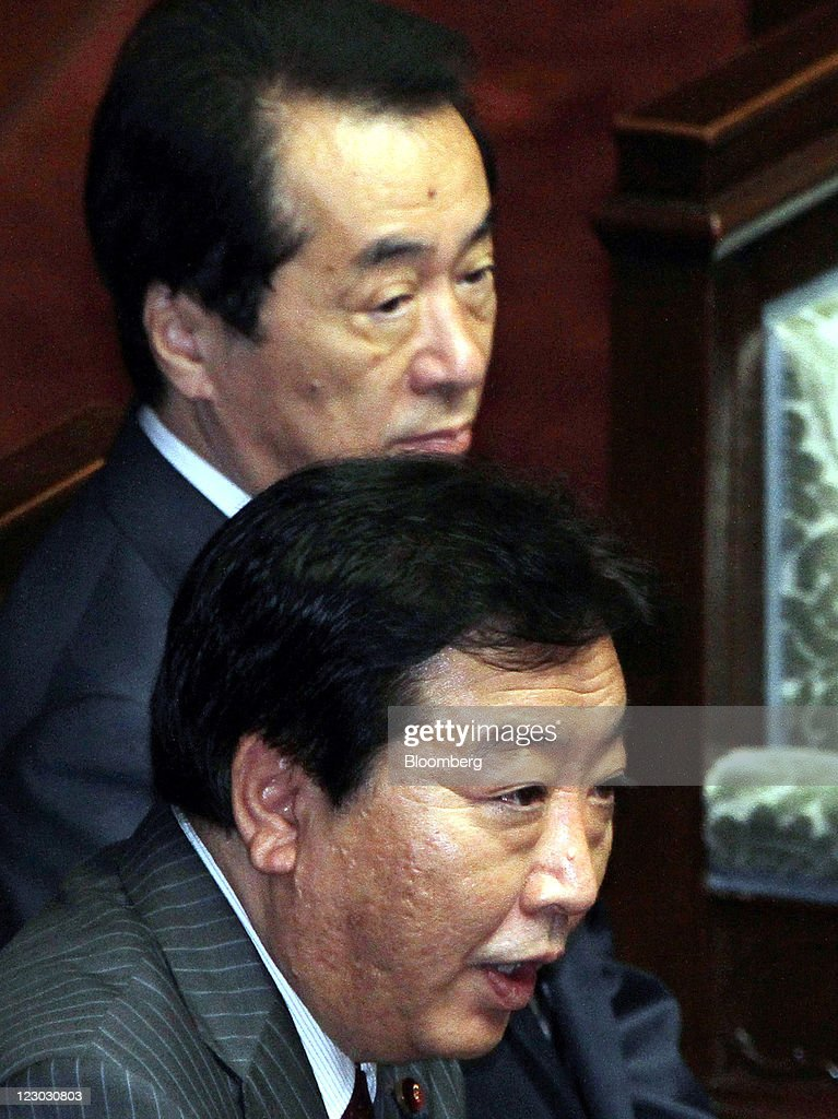 Yoshihiko Noda, president of the Democratic Party of Japan (DPJ) and Japan's newly named prime minister, bottom, and Naoto Kan, Japan's outgoing prime minister, attend a meeting at the lower house of parliament in Tokyo, Japan, on Tuesday, Aug. 30, 2011. Noda becomes Japan's sixth leader in five years, seeking a consensus to raise taxes to pay for rebuilding from the March earthquake and nuclear disaster and reduce the world's largest debt. Photographer: Haruyoshi Yamaguchi/Bloomberg via Getty Images