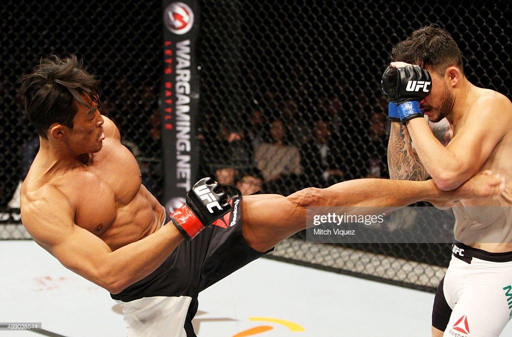 [Image: yoshihiro-akiyama-of-japan-kicks-alberto...d499038544]